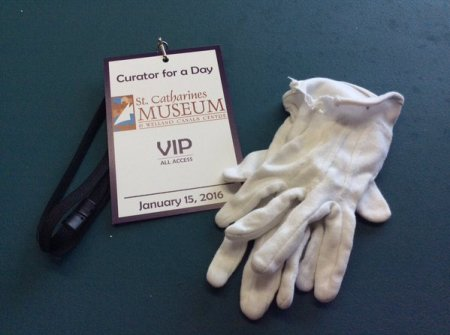 curator for a day VIP badge and white gloves from the Museum's Curator for a Day Program