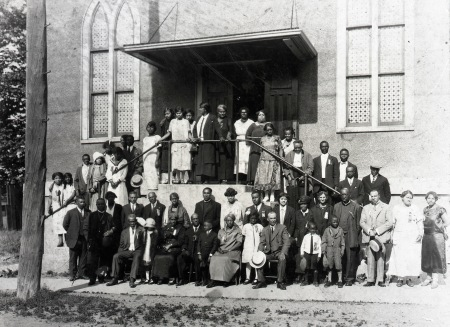 The congregation of the BME Church stands on the steps and ground around the entrance to the Salem Chapel.