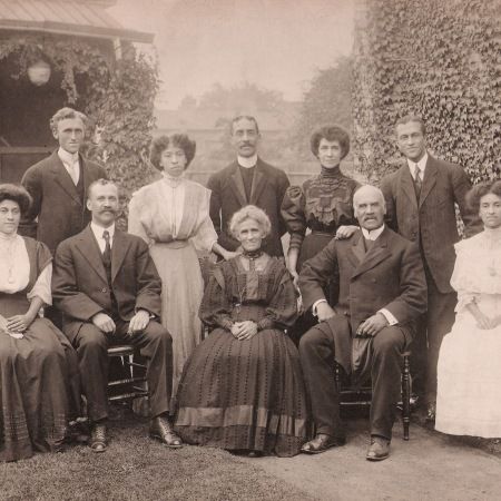 Portrait of the Ball Family. The group of five women and five men are pictured outdoors, with five individuals seated in front and the remainder standing in the rear.