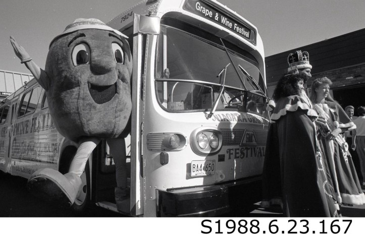 """Mr. Grape with Three Festival Royals and Bus,"" 1988. STCM St. Catharines Standard, S1988.6.23.167."