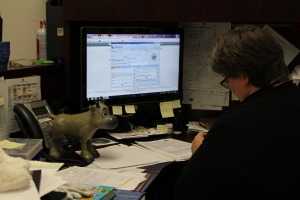 Sven trying to distract Candace with silly faces while she worked on data entry. What a jokester!