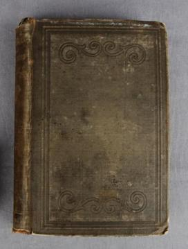 The faded brown cover of this rare book is rather unassuming. STCM 1976.200.35A